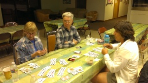 Sue, Dennis, and Sherry playing Hand and Foot Card Game