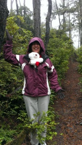 Sherry and our bear Louie on the way thru the rain forest to the beach