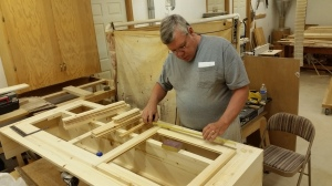 Mike the Master Craftsman creating buffet and table